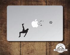 Soccer Player Blasting the Apple Macbook Sticker by DenverDecals