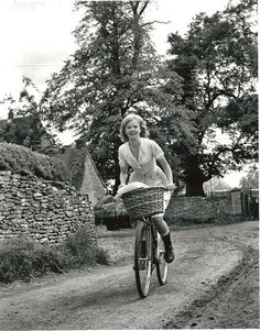 Hayley Mills rides a bike. (she acts in disney movies like pollyanna and the parent trap)