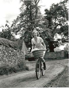 Hayley Mills rides a bike.