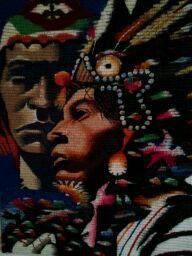 a Native American couple it is a wall hanging my brother gave mom which she did not wanna hang in living room so i put it in my room.