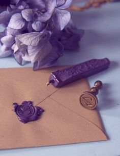 Wedding invitation envelopes sealed with purple wax - LOVE!