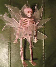 make your own skeleton necklace. Decorate them anyway you want and add string. Dollar store DIY