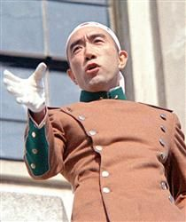 Yukio Mishima during his failed coup of the Japanese government in 1970.  Mishima was a Japanese author, poet, playwright, actor, and film director, and was influential in right-wing Japanese politics. Mishima is considered one of the most important Japanese authors of the 20th century; he was nominated three times for the Nobel Prize in Literature.