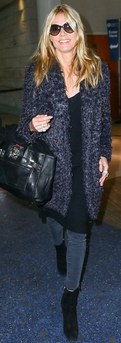Who made  Heidi Klum's fuzzy coat, black handbag, and suede ankle boots?