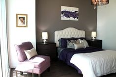 modern bedroom with queen bed frame with white tufted headboard bold blue bedding plus white blanket purple corner chair grey accent wall white walls dark toned wood floors of The Collections of Impressive Interior Decorator Houston for Homes