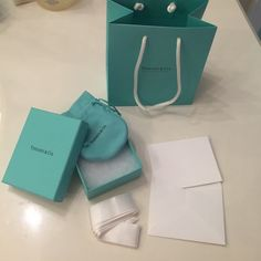 Tiffany & Co Gift Packaging Set Full Tiffany & Co gift packaging set. Comes with paper gift bag, small box with padding, pouch for jewelry, ribbon for box, and card inside an envelope. Adds value to your designer listings/gifts. Other