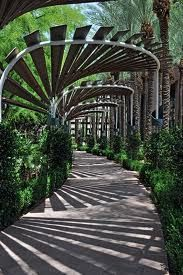 Arched walkway, downtown Phoenix, Arizona.  Shadow falls like a windmill fan..Luv this.. Would like a photo so I could DIY!