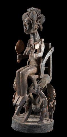 Africa | Sculpture from the workshop of Olowe von Ise, a Yoruba master sculpturer.  Nigeria. | Wood