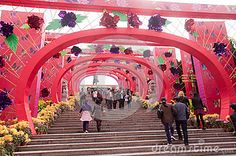 Zhongshan, China - February 23, 2013: Sunwen Memorial Park, at the southern end of Xingzhong Road, is the site of the largest bronze sculpture of Sun Yat-sen in the world.Many people around the park at Chinese holiday