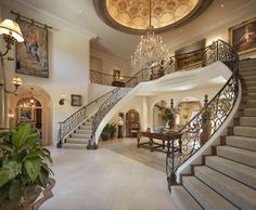 A grand entrance with dual staircases