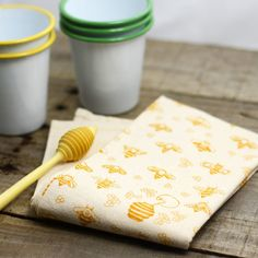 This dish towel looks beautiful hanging on a crisp white oven or even framed as an accent in your kitchen! Featuring honey bees in mustard yellow & cream. Our cotton flour sack towels are made of 100%