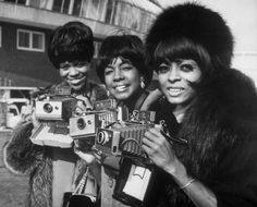 The Supremes with their Polaroid Land cameras. Image credit: Celebrity Camera Club