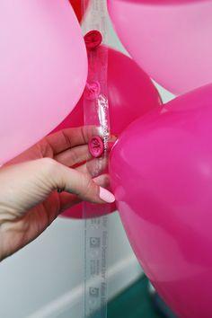 How to Make a Fancy Balloon Arch – Hello!Lucky How to Make a Fancy Balloon Arch How to make a fancy balloon arch via A Beautiful Mess Balloon Garland, Balloon Backdrop, Balloon Ideas, Ballon Arch Diy, Diy Garland, Balloon Balloon, Balloon Arch Tape, Hanging Balloons, Rainbow Balloon Arch