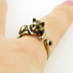 Calling all cat lovers!!! This gold lazy cat ring is slightly adjustable with a gentle squeeze. It fits a size 5-9. She is sweet with Swarovski Crystal eyes as this lazy cat relaxes on your finger and the tail wraps around your finger. Solid Bronze with patina.  This little guy is stronger than...