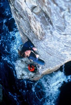 Tasmanian spire looking down. Man, I really hope he's not free soloing. One sick photo.