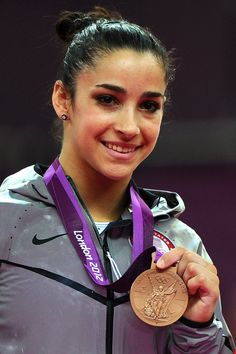 Bronze medalist Alexandra Raisman of the United States poses on the podium during the medal ceremony for the on Day 11 of the London 2012 Olympic Games at North Greenwich Arena on August 7, 2012 in London, England.