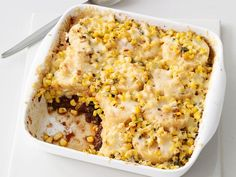 Leftover chili, corn, polenta and Monterey Jack cheese are layered to make this easy yet hearty Chili-Corn Casserole that's great with hot dogs.