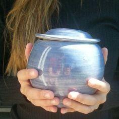 Pet urn with light blue shiny glaze,  medium size.