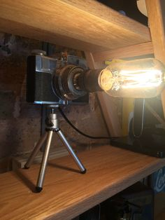 We converted this magnificent lamp you see before you, the Camera stands on a small tripod the vintage bulb glows away looking really cool and comes compete with an on/off switch half way up the ample black flex to the 3 pin plug.