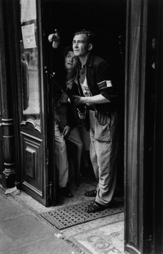 Paris. August 25th, 1944. Members of the French resistance standingin a doorway during the Liberation of the city//Robert Capa