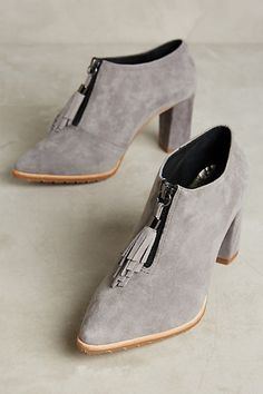LOVE everything about these booties! All Black Lucretia Tassel Booties #anthropologie