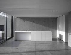Very minimalist kitchen with concrete walls
