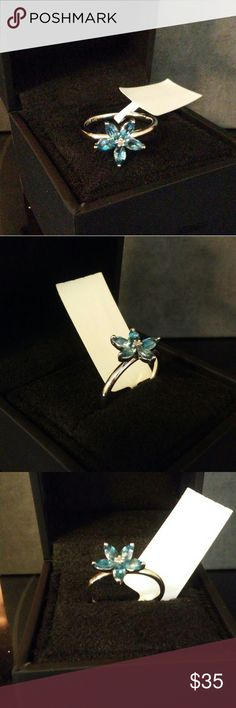 Diamond & london blue topaz 925 silver This product is made from genuine 925 sterling silver genuine London blue topaz flower with genuine diamond in the center the diamond suppliers complied with the Kimberley process to ensure conflict diamonds it's I-J in color and 12 - 13 in clarity stamped Jewelry Rings
