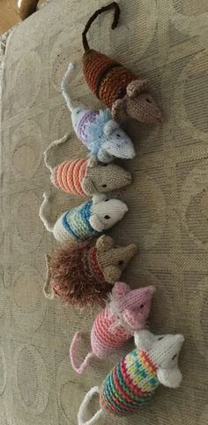 Carol Charnock Creation - several of my knitted catnip mice, made in colours to match the accompanying blanket.