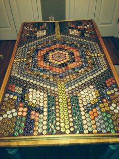 My sis-in-law Jill made this out of beer bottle caps, DIY project so creative!