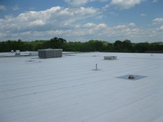 The white cap sheet on this cold-applied modified bitumen roof assembly reflects solar radiation and disperses heat energy away from the building, keeping the interior cool. Heat Energy, Cool Roof, Sustainable Design, Ecology, Sustainability, Solar, How To Apply, Cap, Cool Stuff