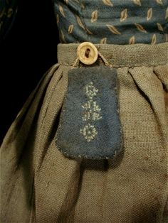 ((27 nov 12 [From of cloth and hand]))  Oh....I'm in love.....FABULOUS piece....the lil' bag hung from a button on such a rough-hewn woven skirt...  this is so beautiful it brings tears to my eyes.....wonderful oddments......