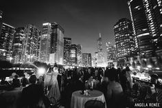 Surrounded by skyscrapers and city lights, this bride and groom are  truly the center of attention. Venue: Chicago's First Lady Cruises   Photographer: Angela Renee