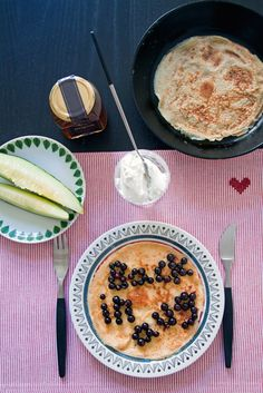 Swedish pancakes with black currants, ricotta and honey.