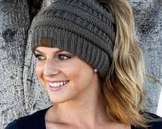 It seems as though, all of a sudden, these adorable beanies are everywhere you look and we are loving the look of these messy-hair don't care knit hats! They are absolutely perfect for the pony-tail lovers of the world! The Soft Knit Ponytail Beanie has a Crochet Beanie, Knitted Hats, Crochet Hats, Messy Bun Knitted Hat, Ponytail Beanie, Beanie Hats, Messy Ponytail, Chapeaux Bonnet Slouchy, Hair Videos