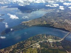 Point Defiance Park peninsula and the narrows bridge (bottom right). Awesome photo! Tacoma, WA.