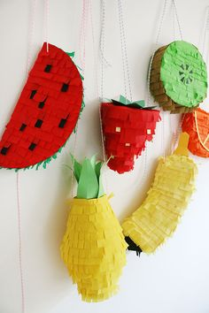 It would be pretty awesome to fill each pinata with corresponding fruit flavors