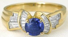Designer 1.30 ctw Round Sapphire and Baguette Diamond Ring in 18k yellow gold. This ring is made of luxurious 18k yellow gold with a gorgeous royal blue sapphire and beautiful tapered baguette diamonds. Found at MyJewelrySource.