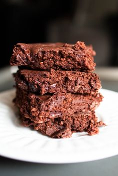 37 calorie brownies 3/4 cup nonfat greek yogurt 1/4 cup skim milk 1/2 cup Cocoa powder 1/2 cup Old fashioned rolled oats (like Quaker) 1/2 cup Truvia (or any natural/stevia based sweetener that pours like sugar) 1 egg 1 teaspoon baking powder 1 pinch salt