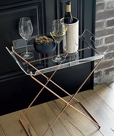 Serve your guests with a removable tray from room to room via cutouts. Space-saving design folds to store out of the way.