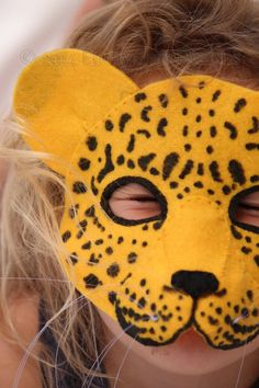 Felt Leopard Mask Pattern .  You can make this quick and easy Leopard mask with a few pieces of felt, some fishing line, some hat elastic and a marker.  Yup.  That's it!  Simple, step by step instructions included for you to look like a star sewer!
