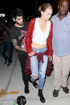 Downcast Zayn Malik hides behind girlfriend Gigi Hadid after pulling out of…