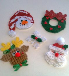 Items similar to Snowman Snowflake Santa Wreath and Reindeer Christmas Magnets on Etsy Plastic Canvas Ornaments, Plastic Canvas Christmas, Plastic Canvas Crafts, Plastic Canvas Patterns, Christmas Crafts, Christmas Ornaments, Reindeer Christmas, Etsy Christmas, Crochet Christmas
