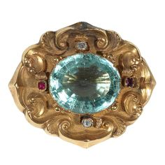 A Late Victorian Aquamarine Gold Brooch/Pendant | From a unique collection of vintage brooches at https://www.1stdibs.com/jewelry/brooches/brooches/