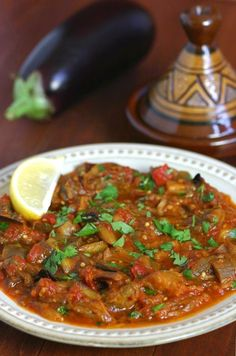 This warm Moroccan Eggplant Salad (Zaalouk) combines cooked eggplant, tomatoes, and classic spices and is enjoyed as a side or alone with lots of bread.(Chicken And Vegetable Recipes) Vegetable Recipes, Vegetarian Recipes, Cooking Recipes, Healthy Recipes, Vegetarian Italian, Eggplant Salad, Clean Eating, Healthy Eating, Eggplant Recipes