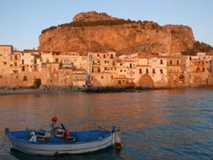 Cefalù - Wedged between mountains and coastline, just an hour's drive east of Palermo, the idyllic town of Cefalu is tiny but popular—especially among sun-seekers from other parts of Italy. Besides gorgeous beaches, Cefalu also offers great Sicilian restaurants and a hip nightlife scene, particularly in the summer months when its population triples.
