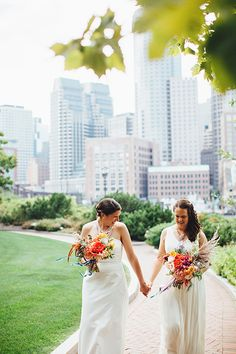 Coordinating long white @jcrew wedding dresses   @firstmatephoto   Brides.com