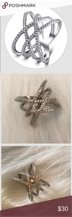 NWT Chic Silver Filigree Double Crisscross Ring This ring is so cool! It is fit for and occasion! It is an 18k fill over alloy metal! It is a very comfortable ring too! Boutique Jewelry Rings