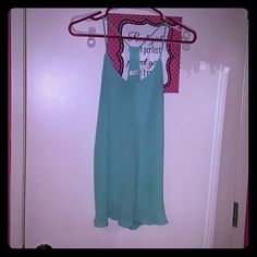 Layered sheer top. Light turquoise Racer back cute top.  Thin straps. Slinky and sheer but 2 layers so not see through. Tops Blouses