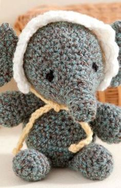 Baby's Elephant Crochet Pattern This sweet baby elephant is a cute addition to baby's nursery. It crochets up quickly and is easy to keep clean with machine washing. Bigger eyes would be cute. Red Heart Free Pattern - no membership required