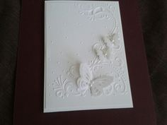 A white on white card with butterflies I made